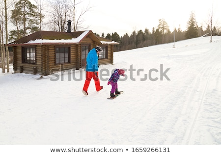 Father Riding Snowboard With His Daughter Stock photo © AndreyPopov