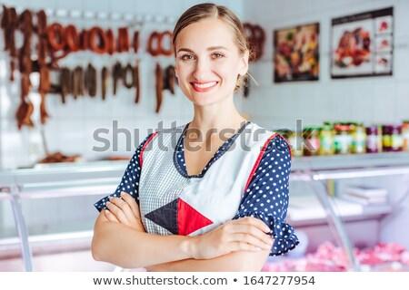 Orgoglioso donna carne salsicce macellaio Foto d'archivio © Kzenon