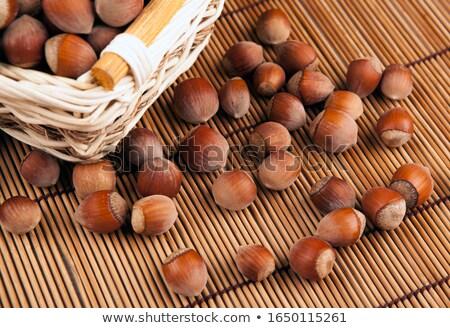 Geheel hazelnoot mand bamboe servet Stockfoto © mizar_21984