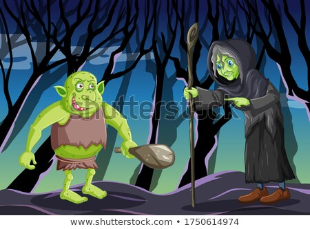 Wizard or witch with goblin or troll on dark forest background Stock photo © bluering