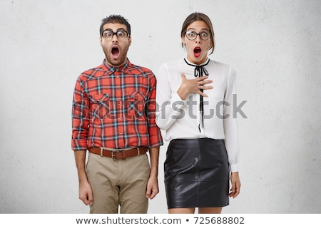 Portrait of surprised couple expressing excitement and looking u Stock photo © deandrobot