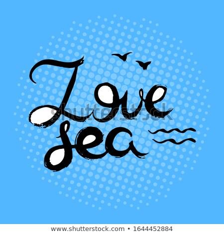Szeretet tenger homok tengerpart háttér óceán Stock fotó © fyletto