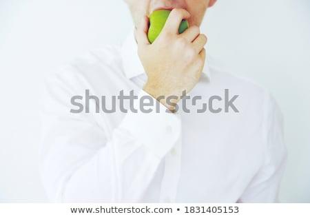 young man biting an apple stock photo © aladin66