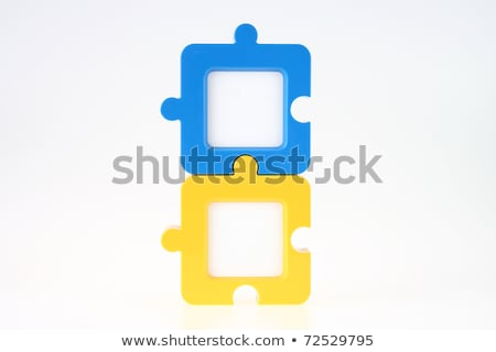 couple of jigsaw shape photo frame in blue and yellow stock photo © pinkblue