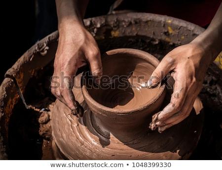 Kezek gyermek segítség munka kerámia kerék Stock fotó © vrvalerian