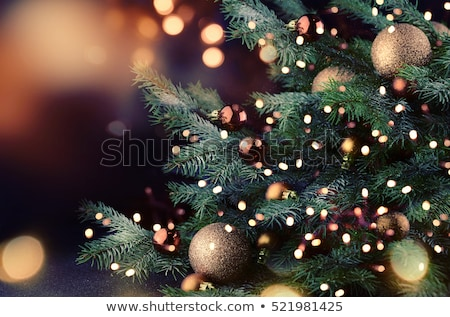 illuminated Christmas tree on golden background Stock photo © Artida