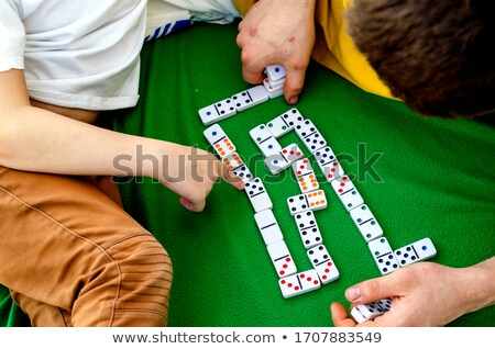 Young boy playing dominoes with his father Stock photo © photography33