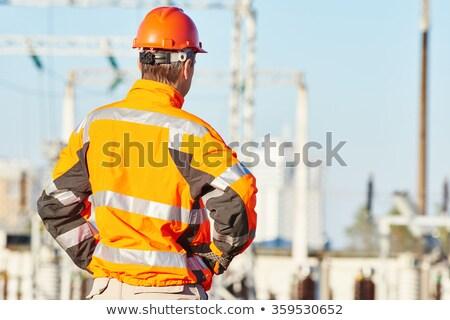 Man hoog zichtbaarheid kleding gras bouw Stockfoto © photography33