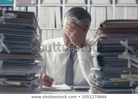 Office worker overwhelmed by load of work Stock photo © photography33