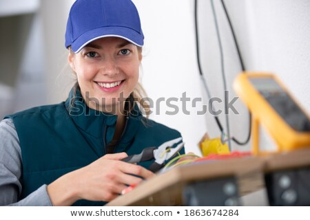 young woman fitting an electrical socket stock photo © photography33