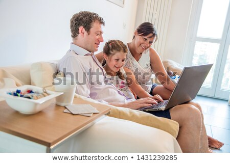 parents and their little girl having fun on the internet stock photo © photography33