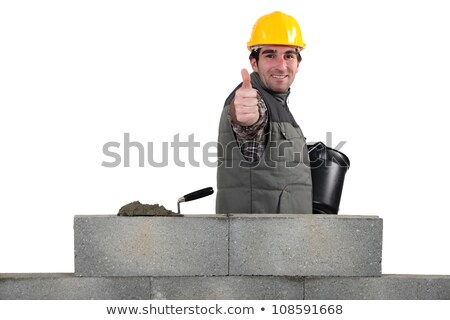 Mason giving the thumbs-up as her builds wall Stock photo © photography33