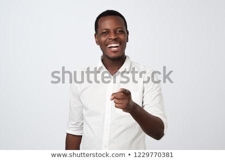 casual · adolescente · tipo · senalando · aislado · blanco - foto stock © stockyimages