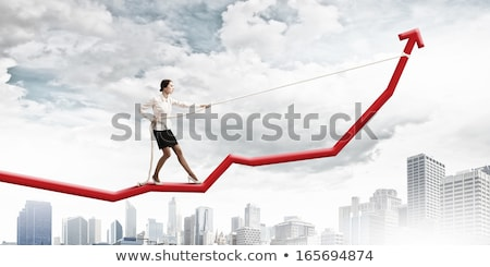 Woman drawing a red upwards arrow Stock photo © photography33