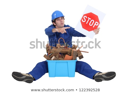 builder sat with box of rubble to be recycled stock photo © photography33