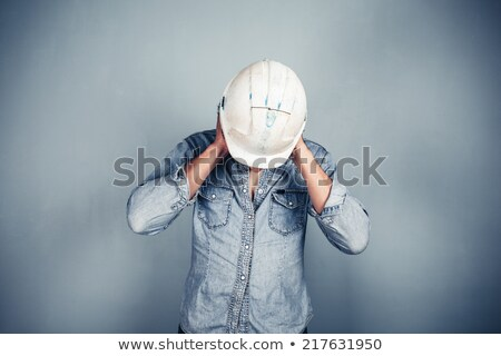 Tradesman covering his ears Stock photo © photography33