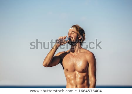 man running on the beach in water portrait Stock photo © juniart