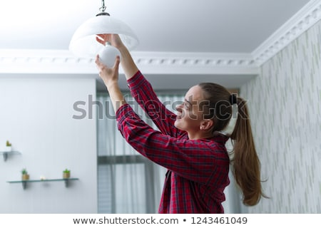 Female electrician with lightbulbs Stock photo © photography33