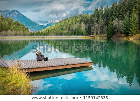 Gyönyörű lány kék ég portré gyönyörű barna hajú lány Stock fotó © bartekwardziak