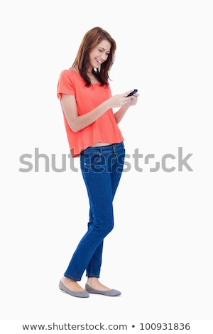 Laughing adolescent sending a text with her mobile phone Stock photo © wavebreak_media