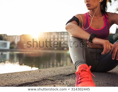 Runner riposo femminile jogger lungo eseguire Foto d'archivio © ruigsantos