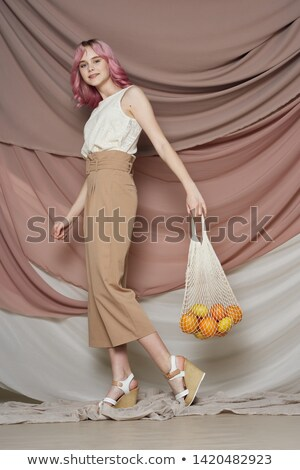 Mod style woman with pink lips on white background Stock photo © wavebreak_media