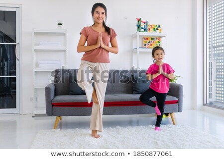 Portrait of adorable young girl and mother studying drawing at h stock photo © HASLOO