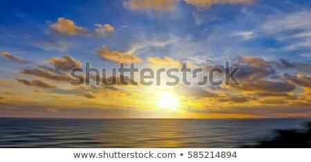 Nascer do sol mar lago luz laranja oceano Foto stock © dacasdo