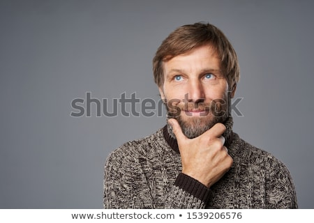 Man warming up with casual pullover in wintertime Stock photo © HASLOO