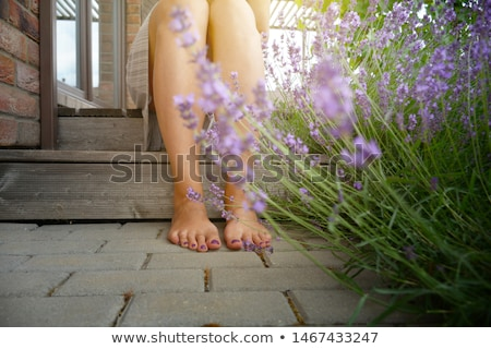 Kadın çiçekler görmek güzel kırmızı tırnaklar Stok fotoğraf © juniart