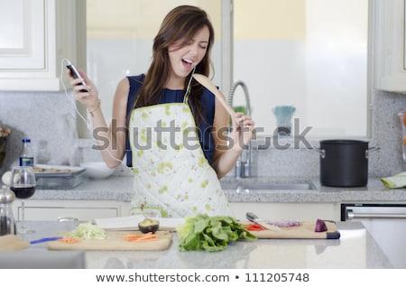 Stock photo: Beautiful brunette woman singing