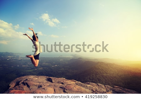 Brave girl jumping from rocks Stock photo © Anna_Om