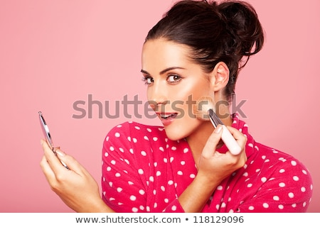 Laughing beautiful woman applying blusher Stock photo © dash