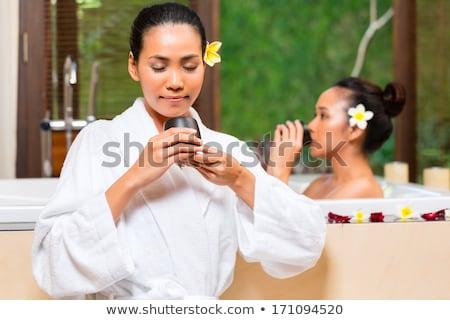 Indonéz nő wellness fürdőkád fürdő ázsiai Stock fotó © Kzenon