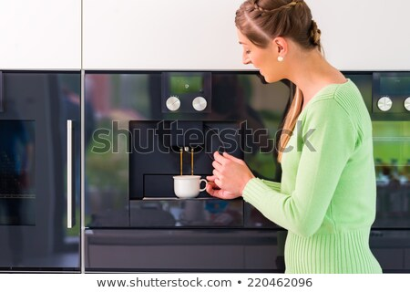 woman using fully automatic coffee machine at home stock photo © kzenon
