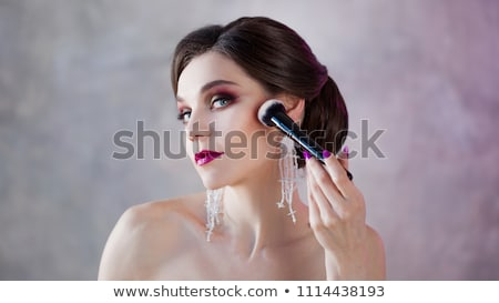 Beautiful girl doing makeup with red lipstick Stock photo © vlad_star