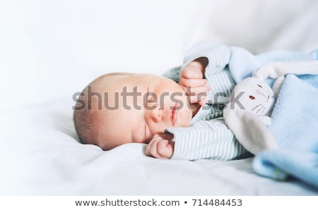 Paisible bébé lit souriant blanche Photo stock © Len44ik