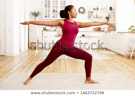 woman practicing warrior yoga pose stock photo © hasloo