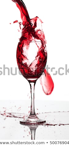 alcohol drink pouring into glass isolated on white background Stock photo © jarin13