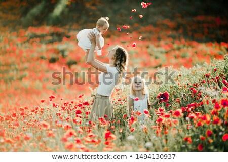 mom with her child in poppy field Stock photo © stryjek