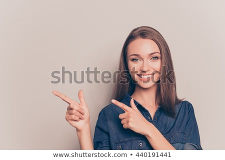 portre · gülümseyen · kadın · işaret · parmak · uzak · bo - stok fotoğraf © deandrobot