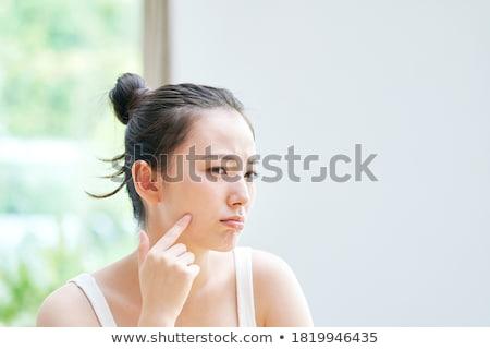 женщину прикасаться щека молодые розовый улыбаясь Сток-фото © imagedb