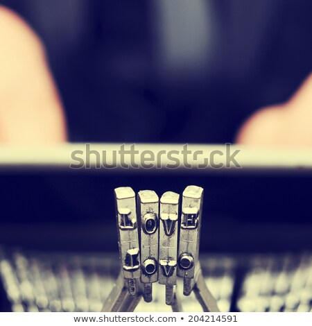 Stock photo: typebars of an old typewriter forming the word love