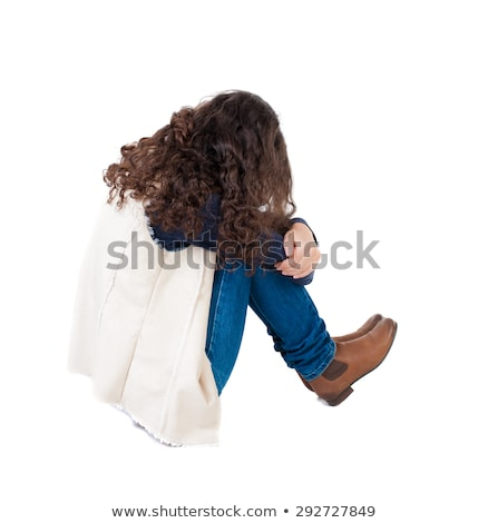Stock photo: Sad girl sitting over white background