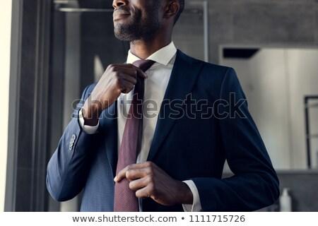 Genç işadamı pansuman ceket portre yalıtılmış Stok fotoğraf © deandrobot