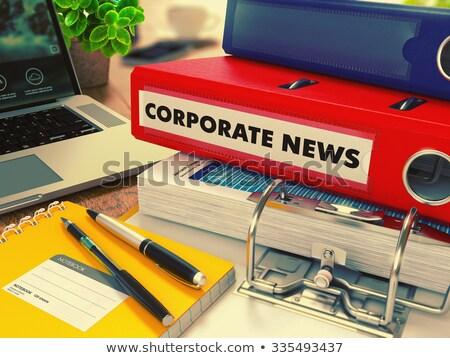 red office folder with inscription corporate news stock photo © tashatuvango
