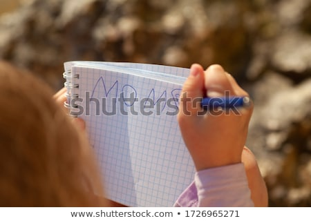 little girl sits on beach near to water from stones word is combined summer stock photo © paha_l