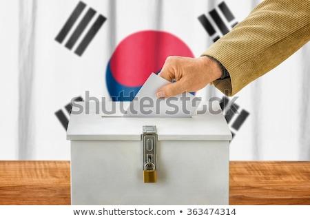 Man putting a ballot into a voting box - South Korea Stock photo © Zerbor