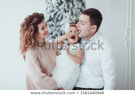 Winter Beautiful Girl licking candy Stock photo © zurijeta