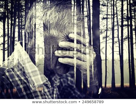 Double exposure of desperate senior man suffering and covering f Stock photo © zurijeta
